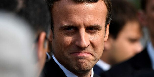 French President Emmanuel Macron greets the crowd after a mass to pay tribute to French priest Father...