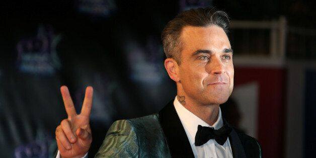 Singer Robbie Williams arrives to attend the NRJ Music Awards ceremony at the Festival Palace in Cannes, France, November 12, 2016. REUTERS/Eric Gaillard