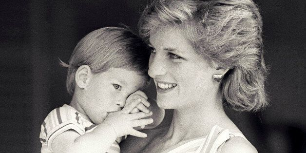 FILE PHOTO - Britain's Princess Diana holds Prince Harry during a morning picture session at Marivent...