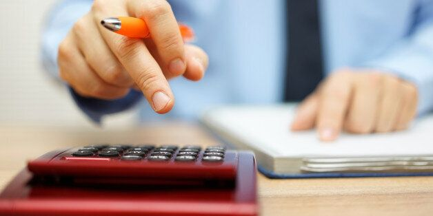 shallow depth of field of accountant calculating financial