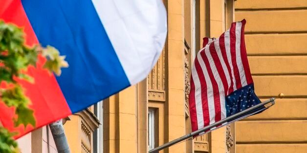 A Russian flag flies next to the US embassy building in Moscow on July 31, 2017.President Vladimir Putin...