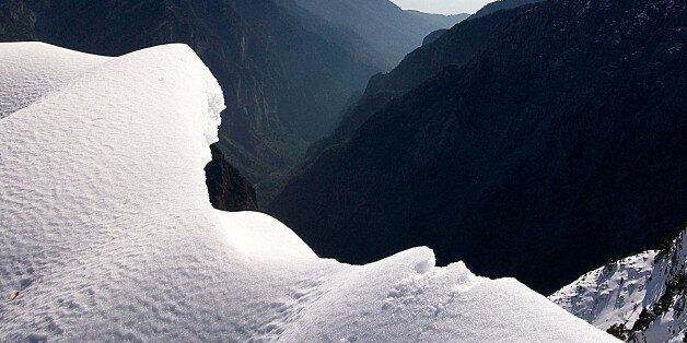 SAMARIA GORGE FROM ABOVE WITH SNOW ON THE PEAKS,WHITE