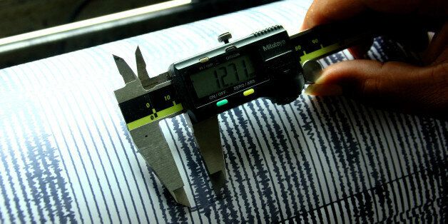 PROBOLINGGO, EAST JAVA, INDONESIA - 2016/10/07: Officer checked and seismic activity detector (seismograph)...