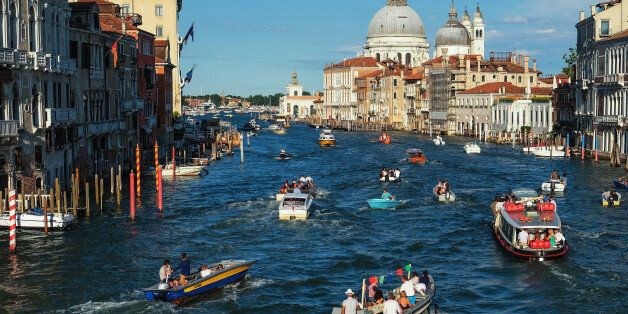 VENICE, ITALY - JULY 15: Boats sail the Grand Canal to reach the St. Mark basin on the day of the Redentore...
