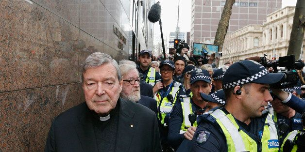 MELBOURNE, AUSTRALIA - JULY 26: Cardinal George Pell walks with a heavy Police guard from the Melbourne...