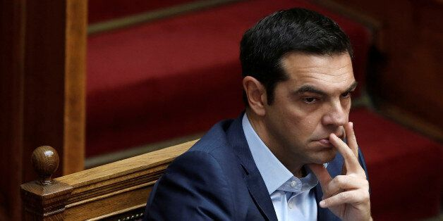 Greek Prime Minister Alexis Tsipras attends a parliamentary session on the collapse of Cyprus peace talks...