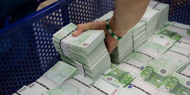 An employee of GSA Austria (Money Service Austria) stacks wads of new 100 euro banknotes at the company's...