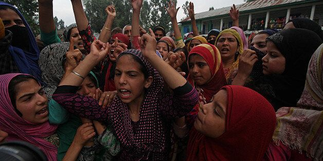 INDIA - 2017/07/18: Girls shout pro freedom slogans during the funeral of Showkat Ahmad Lohar a rebel...