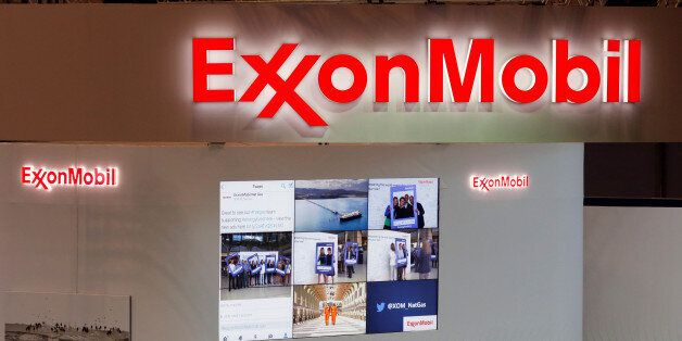 Logos of ExxonMobil are seen in its booth at Gastech, the world's biggest expo for the gas industry,...