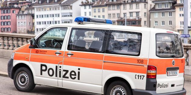 Zurich, Switzerland - 4 December, 2015: a parked van of Zurich Municipal Police, old town buildings in...