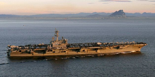 The aircraft carrier USS George H. W. Bush (CVN 77) transits the Strait of Gibraltar into the Mediterranean...
