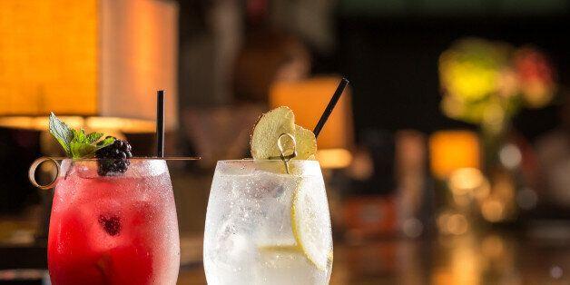 Two glasses of frozen lemonade on bar counterTwo glasses of frozen lemonade on bar