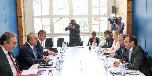 CRANS-MONTANA, SWITZERLAND - JULY 06: Foreign Affairs Minister of Turkey Mevlut Cavusoglu (2nd L) meets...