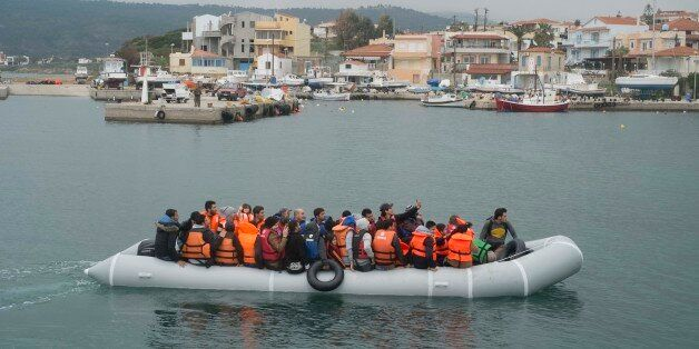 Migrants arrive in Mytilene, on the Greek island of Lesbos, on March 21, 2016. Like Lesbos, Chios is...