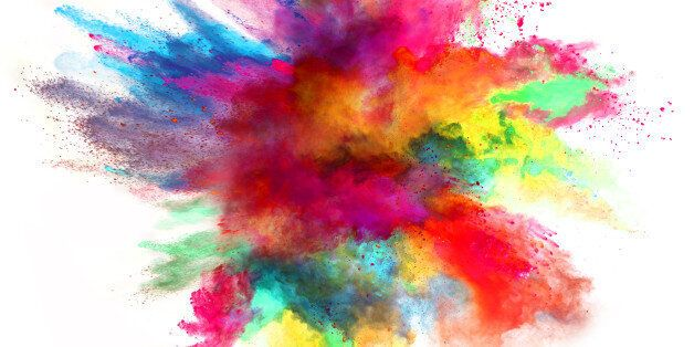 Explosion of colored powder, isolated on white