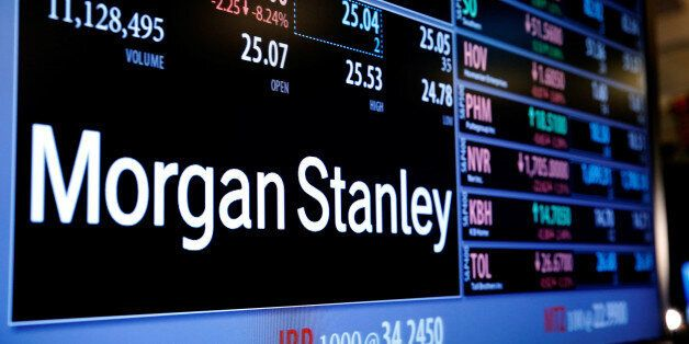 Information for stock in Morgan Stanley (MS) is displayed above the floor of the New York Stock Exchange...