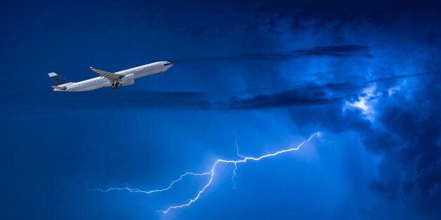 Commercial airplane take off flying over storm clouds and lightning. Elegant Design with copy space for...