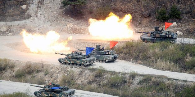 South Korean Army K1A1 and U.S. Army M1A2 tanks fire live rounds during a U.S.-South Korea joint live-fire...