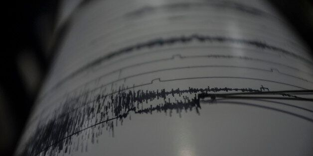KARO, INDONESIA - AUGUST 25: The geology staff monitors the activity of volcano on the seismograph as...