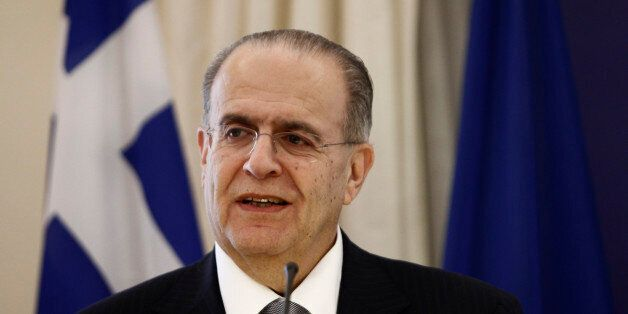 Cyprus' Foreign Minister Yannakis Kasoulidis addresses journalists during a news conference in Athens...