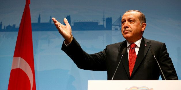 Turkish President Recep Tayyip Erdogan gestures during a news conference to present the outcome of the...