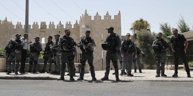 Israeli security forces stand guard in Jerusalem's Old City on July 14, 2017 following a shooting attack.Three...