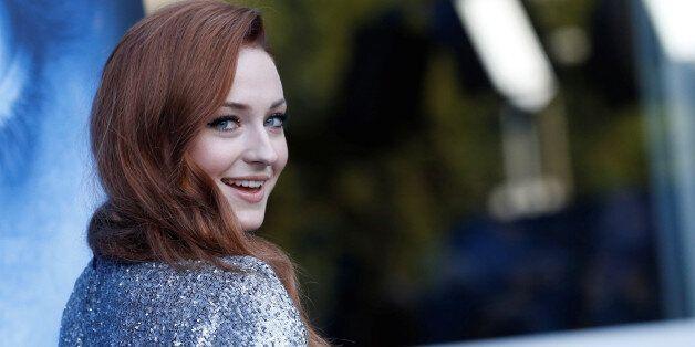 Cast member Sophie Turner poses at a premiere for season 7 of the television series