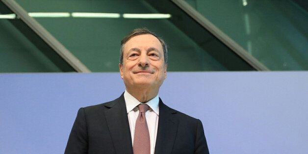 Mario Draghi, president of the European Central Bank (ECB), arrives for a news conference following the...