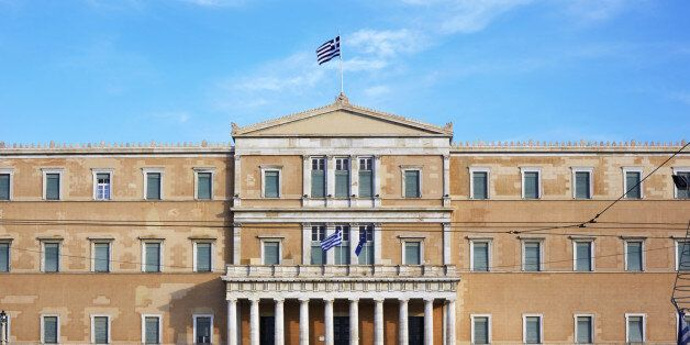 Tourists outside the old parliament building of Athens in Syntagma