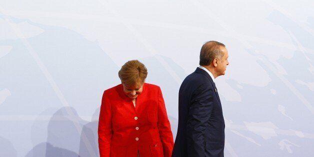 HAMBURG, GERMANY - JULY 07: German Chancellor Angela Merkel (L) welcomes Turkish President Recep Tayyip...