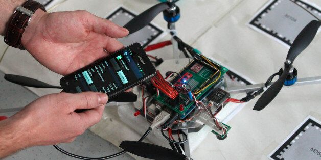 A student of the Virtual-Reality-Team at Vienna University of Technology checks a smartphone before attaching...