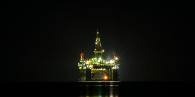 A night view of the oil drilling platform lit up on the coast of Limassol, in Cyprus. The oil rig is...