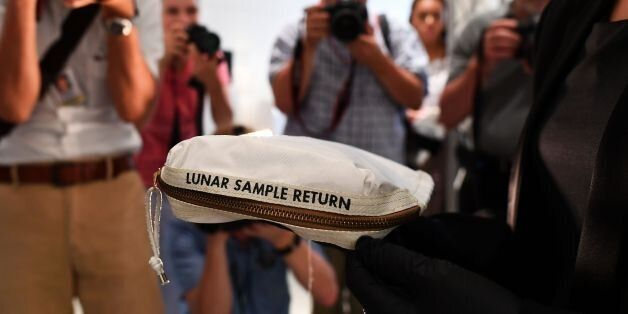 Sothebys Cassandra Hatton displays the Apollo 11 Contingency Lunar Sample Return Bag, used by Neil Armstrong...