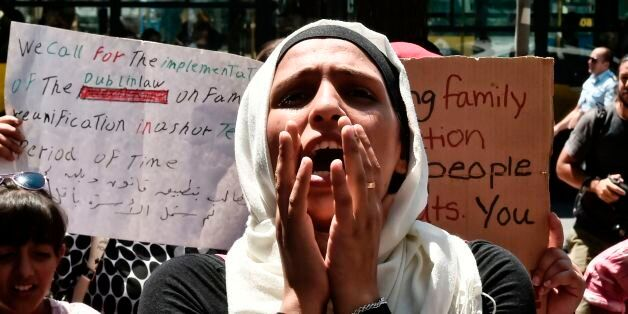 A Syrian woman shouts outside the German embassy in Athens on July 19, 2017 during a protest against...