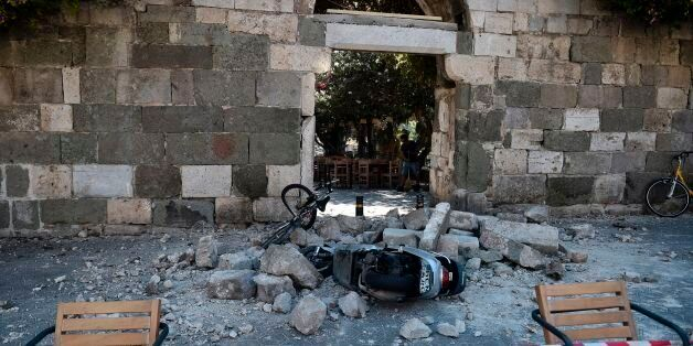A man sweeps away rubble following on the Island of Kos following a 6.5 magnitude earthquake which struck...