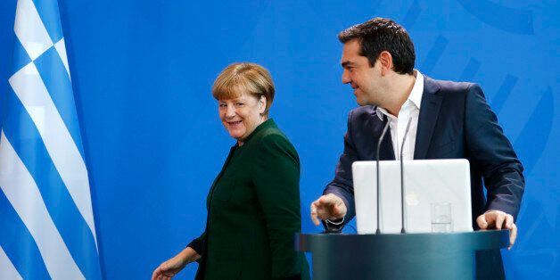 German Chancellor Angela Merkel and Greek Prime Minister Alexis Tsipras (R) leave after a statement at...