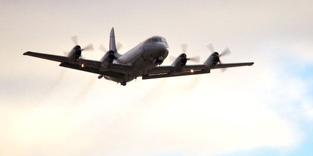PERTH, AUSTRALIA - APRIL 16: A Royal New Zealand Air Force P3 Orion takes off from RAAF Pearce to assist...