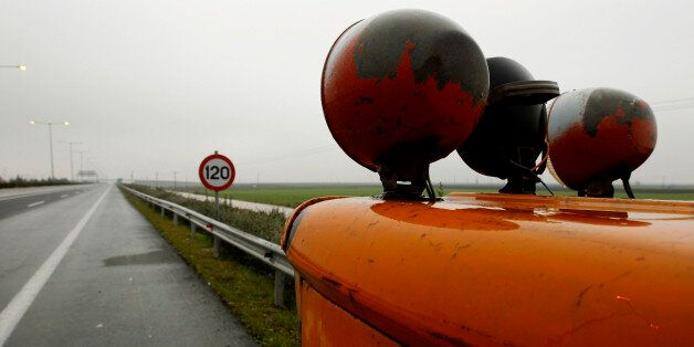 A tractor blocks the main motorway linking Athens to northern Thessaloniki close to Larissa town January...