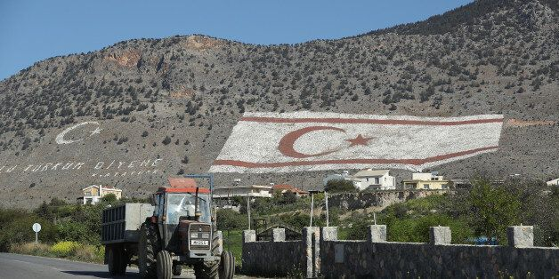 TASKENT, CYPRUS - MARCH 06: A tractor in the Turkish Republic of North Cyprus (TRNC) drives by a massive...