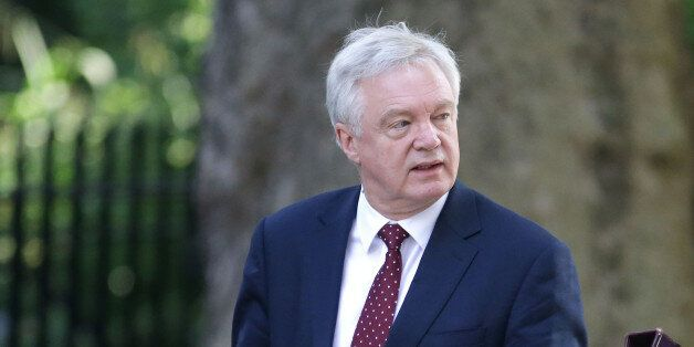British Secretary of State for Exiting the European Union (Brexit Minister) David Davis (L) and Britain's...