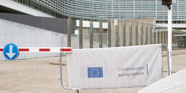 A European Union (EU) flag sits on a barrier outside the European Commission Berlaymont building in Brussels,...
