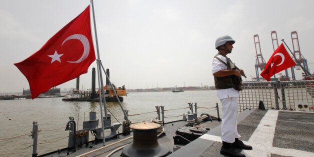 A Turkish Maritime Task Group personal stand guards on the TCG Barbaros ship anchored off Karachi Port...