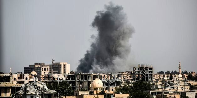 Smoke billows following an airstrike on the western frontline of Raqa on July 17, 2017, during an offensive...