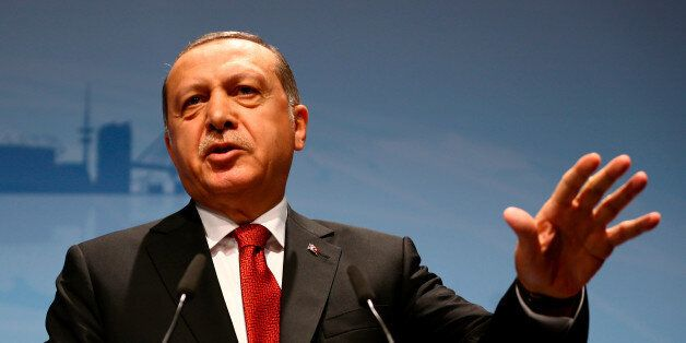 Turkish President Recep Tayyip Erdogan speaks during a news conference to present the outcome of the...