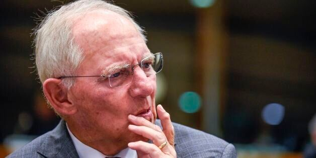 German Finance Minister Wolfgang Schaeuble looks on during an Ecofin meeting at the EU headquarters in...