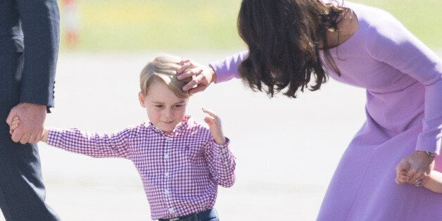 HAMBURG, GERMANY - JULY 21: Prince George andand Catherine, Duchess of Cambridge view helicopter models...