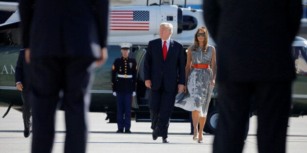 U.S. President Donald Trump and First Lady Melania Trump board Air Force One during their departure back...