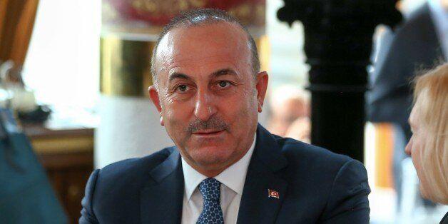 SIERRE, SWITZERLAND - JUNE 27: UN chief's special adviser on Cyprus Espen Barth Eide; Turkish Foreign...