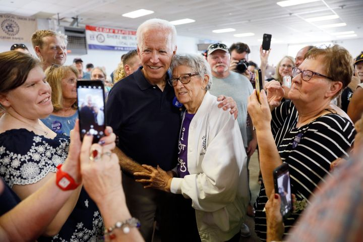 Democratic presidential candidate former Vice President Joe Biden gets a hug from Ruth Nowadzky, of Cedar Rapids, Iowa, durin