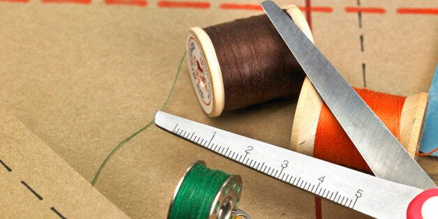 Tailor's tools shot macro. The photograph contains material used by a tailor when sewing. There are many...